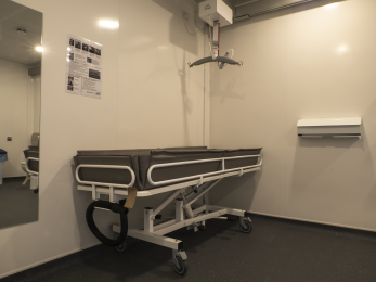 Guldmann cover overhead hoisting equipment and shower trolley