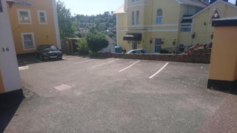 This is the car park which slopes down to the front door from the driveway entrance