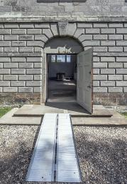 View of the front of the Chapel showing the ramp, doorway and gravel path