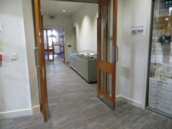 Corridor doors on left from main entrance to accessible toilet