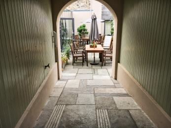 Access into the courtyard garden via a gentle slope
