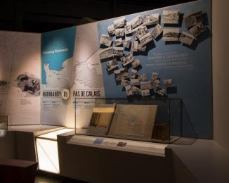 The first gallery of the D-Day Story. Light levels are low and there are spotlights.