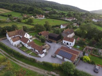 High level view of Home Farm showing gravel paths around buildings