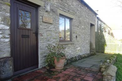 slightly sloping ramp to front door