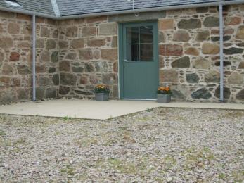 Parking area outside cottage