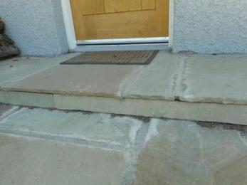 Step from entrance to patio area