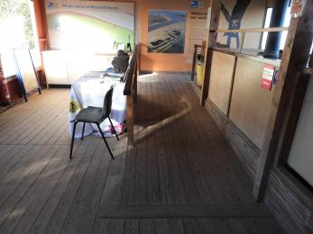 Gentle wooden ramp leading to spacious viewing area with access to wood burner.