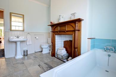 Ground floor bathroom with bath, toilet and basin.