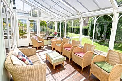 Conservatory leading outside to a patio area