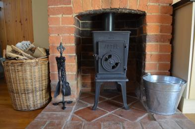 Woodburning stove and log basket.