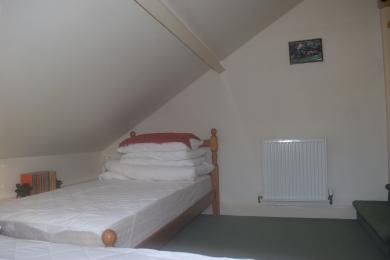 Twin Room with sloping ceiling and 2 steps down.