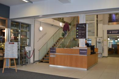 This is the main entrance, showing the stairs up to the library and help desks, it also shows the lift access on the right.