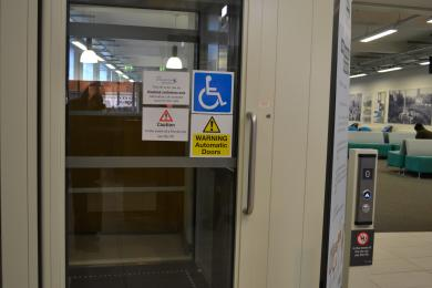 The door of the platform lift on the ground floor, accessible via the main entrance.