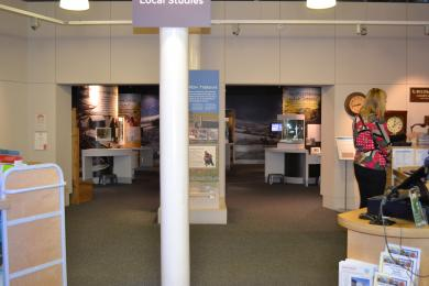 This photo shows the entrance to the Hallaton Treasure gallery, between the two help desks. There is a column in the middle.
