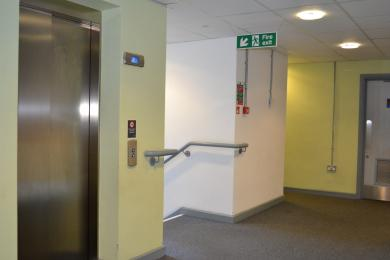 This is the door to the main lift on the first floor, located next to the toilets.