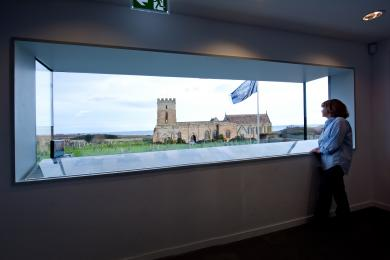 Panoramic window looking out over the church