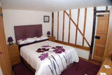 Easy access bedroom with usual furniture in place. The wardrobe clothes rail is 1450mm high. The divan bed is 600mm high.