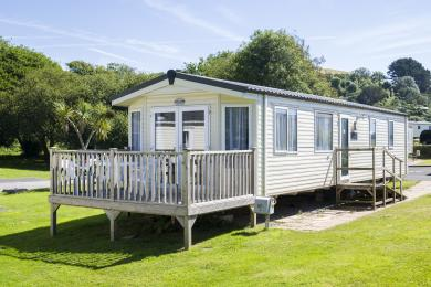Exterior of a standard holiday home with ramp and decking