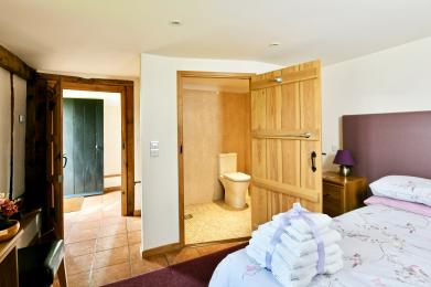 Easy access bedroom with furniture moved showing entrance & access to wet room.