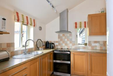 Kitchen work surface height is 900mm.