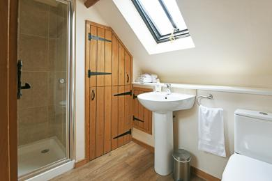 1st Floor Shower room with wash hand basin and toilet.
