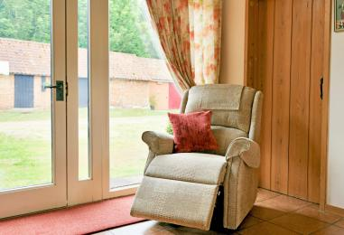 Electric riser/recliner chair in lounge