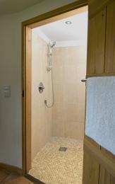 The wet-room is en-suite. The wet-room door is 800mm wide. A shower stool is available. The comfort toilet seat is 490mm high.