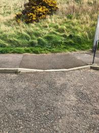 Dropped Kerb bottom of access slope