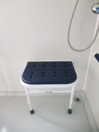 Photo of shower seat in the wheelchair accessible caravan