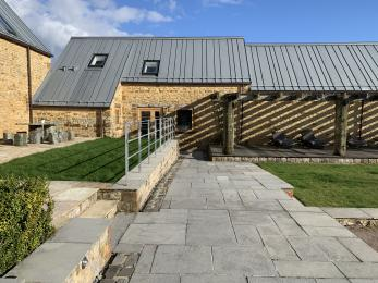 The Cart Shed - Journey through communal courtyard with gentle slope