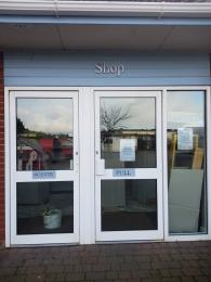 A photo of the side-hing entrance to the shop