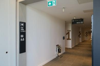 Entrance to the Oak Suite function rooms and signs to the toilets area viewed from the reception seating area
