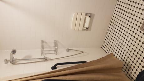 Shower with fixed shower seat