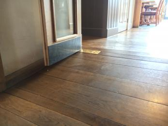 Gentle slope up the hallway into the reception area