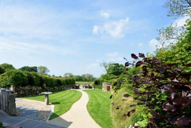 Enjoy views over a verdant garden and meadows at this luxury cottage Cornwall