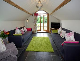 Double doors lead to the lounge from the open plan kitchen-diner, then out to the garden