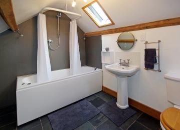 Large bathroom with double-end spa bath and shower.