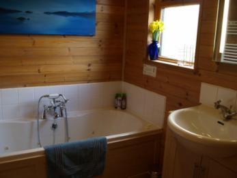 Hipley bathroom with double ended whirlpool bath