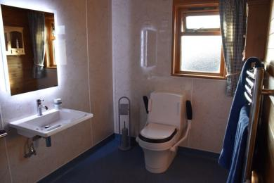 Hipley wet room with Closomat toilet with drop down handrails