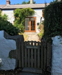 View of Hollowtree cottage pedestrian gate leading to front entrance.