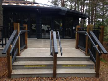 Three steps with hand rails up to the Nature Centre
