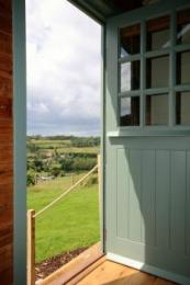 Access & entrance to the Shepherd's hut via 5 steps and split stable door at the top of the steps.