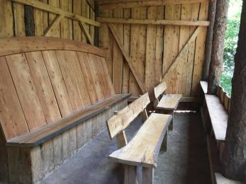 Three wooden benches. Back on one bench is angled to improve comfort when watching the tree tops. No arms on the benches.