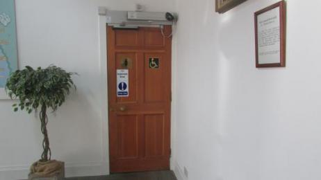 Automatic opening door which leads to the disabled toilet