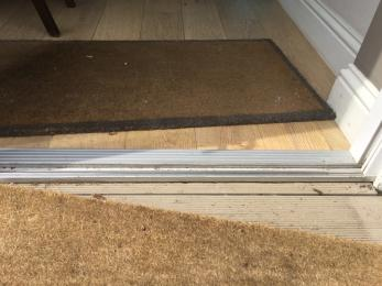 Low threshold onto decked terrace, removable floor mats
