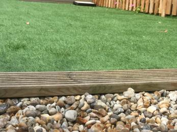 Close up of threshold separating Garden to Fire Pit area