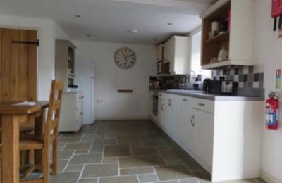 Open plan kitchen and dining area at Doodale Cottage