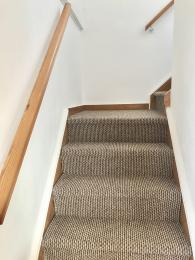 Stairs up to both bedrooms have a hand rail (11 steps in total)