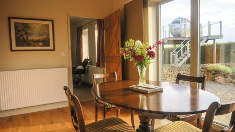 Dining table in the lounge has a lovely outlook.  It is easy for guests in wheelchairs to dine at this table.