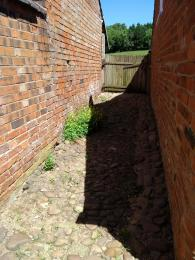 Cobbled alleyway to garden.